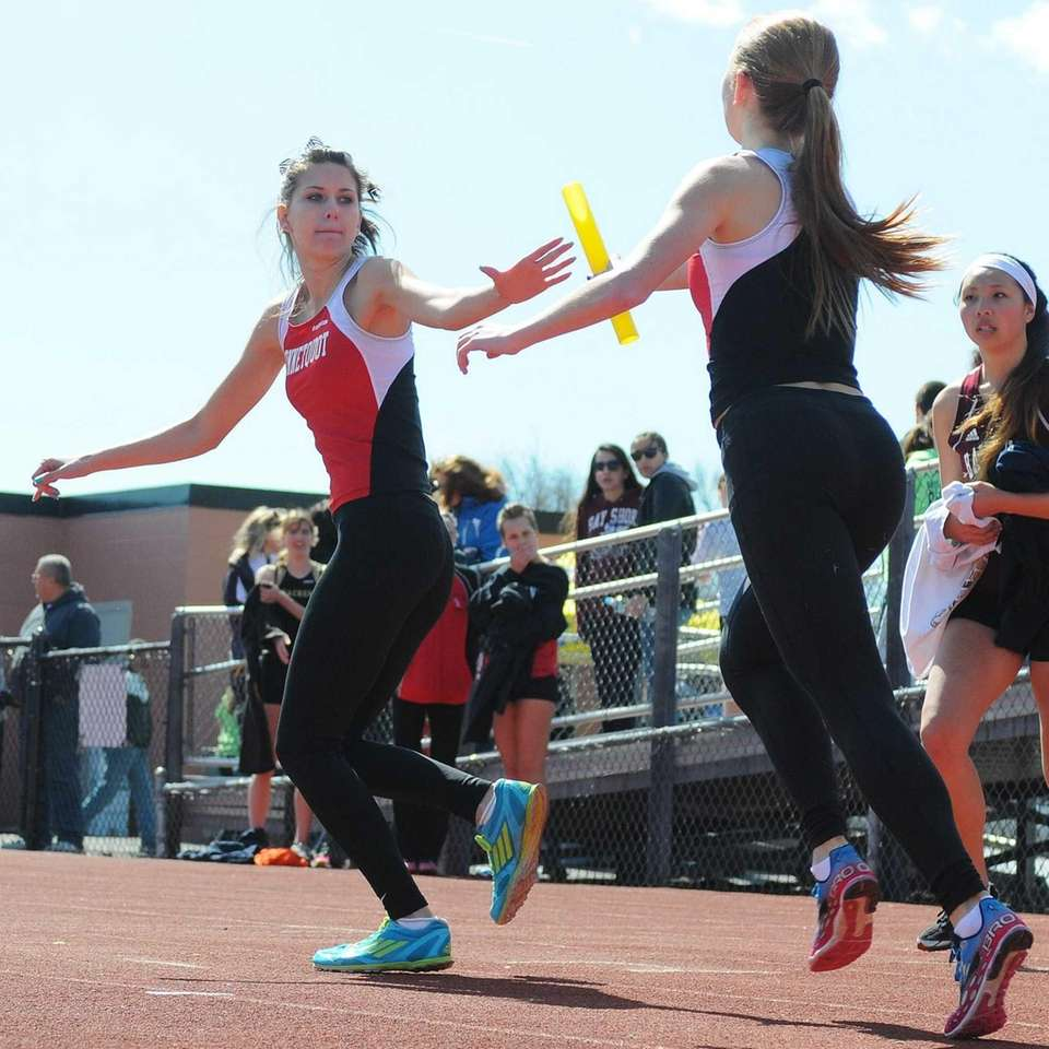 Connetquot senior Amy Irving, left, takes a baton