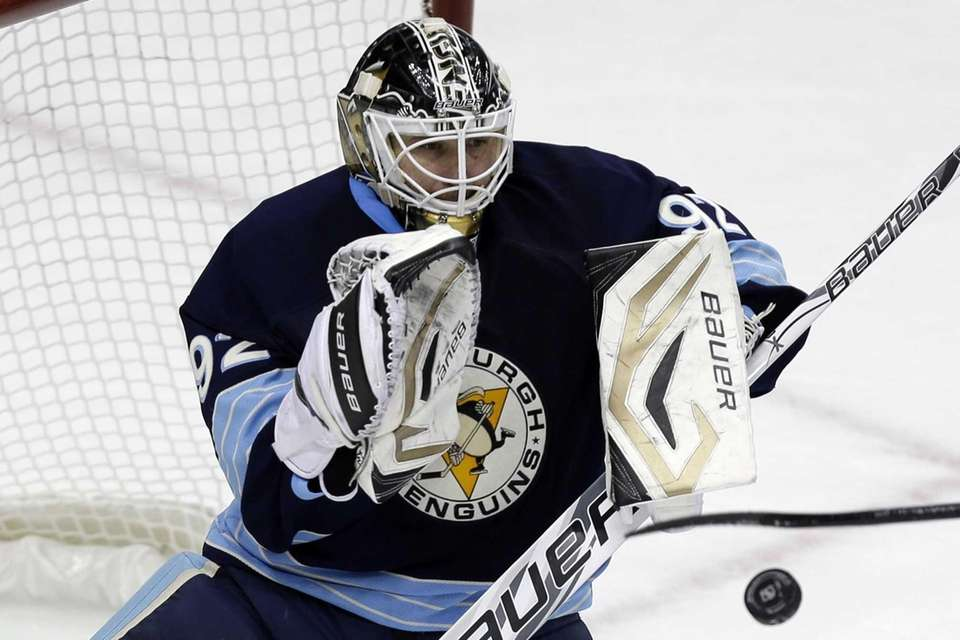 Pittsburgh Penguins goalie Tomas Vokoun stops a shot