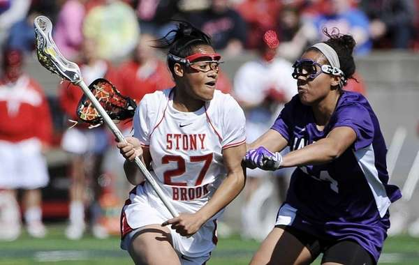 Stony Brook midfielder Demmianne Cook is defended by