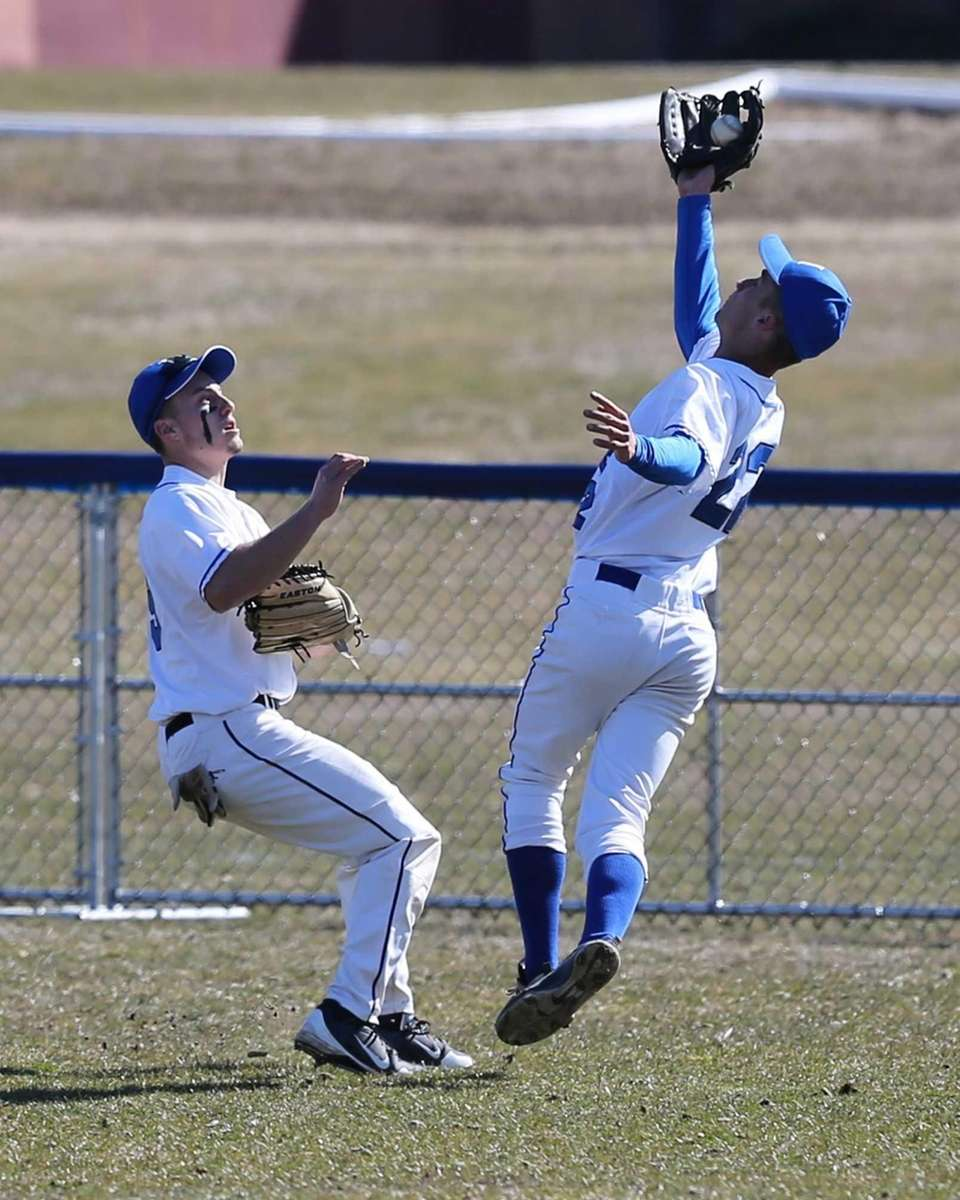 Hauppauge right fielder Nick Fanti avoids a collision