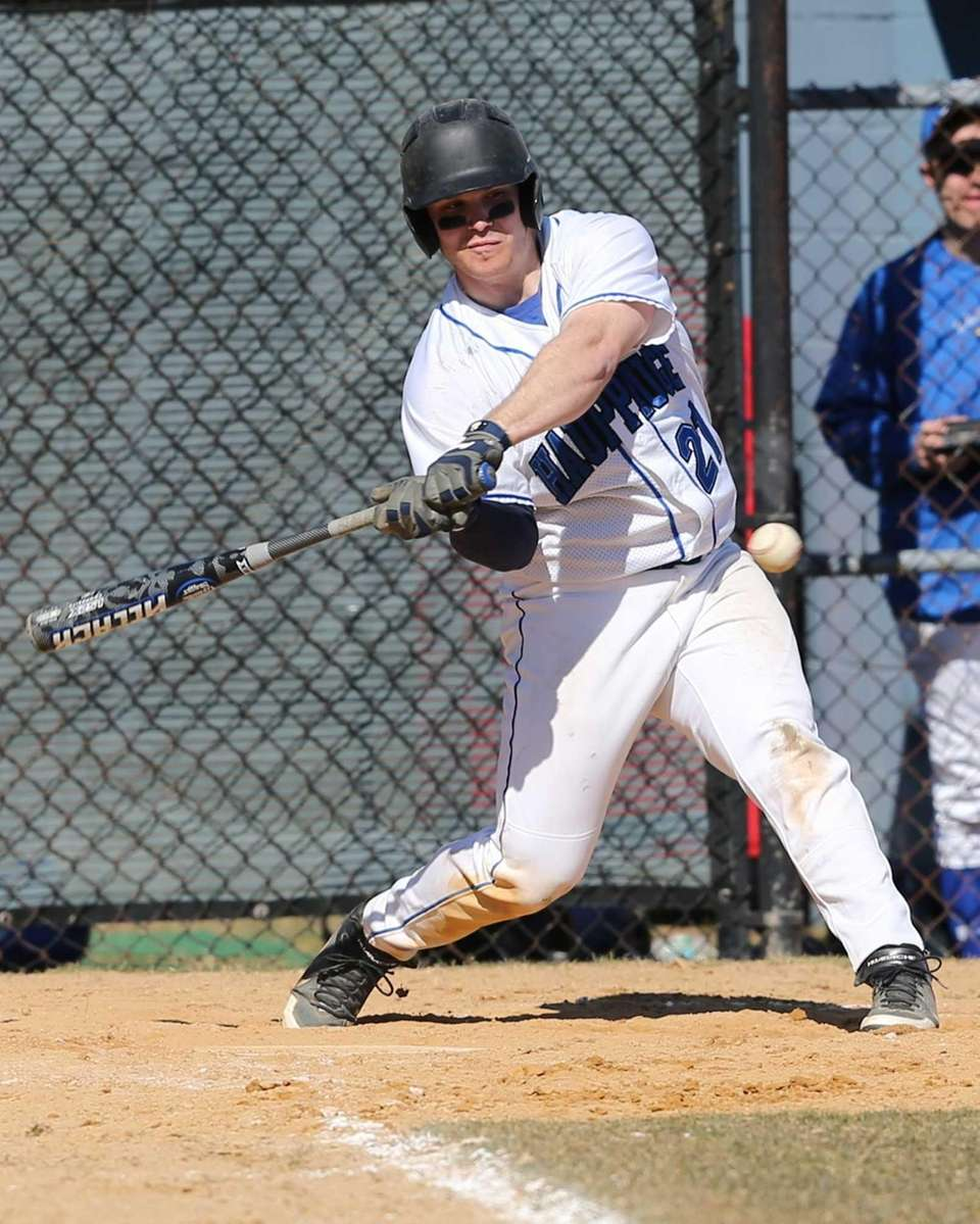 Hauppauge shortstop Dom Confredo hits against Kings Park.
