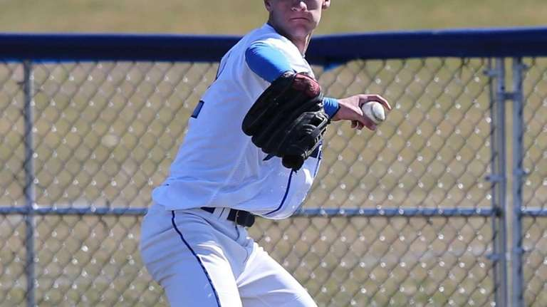 Hauppauge outfielder Nick Fanti throws to second base