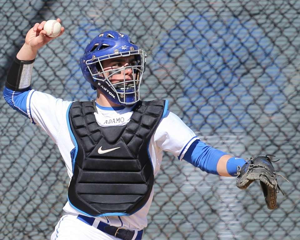 Hauppauge catcher Austin Adamo throws to third to