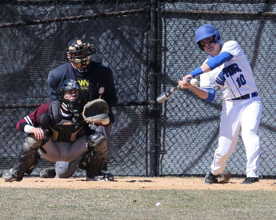 Hauppauge catcher Austin Adamo takes a swing while