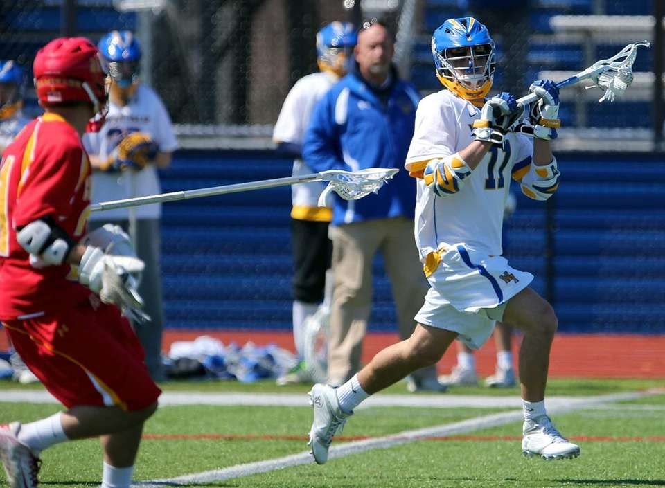 West Islip's Nick Aponte looks to pass as