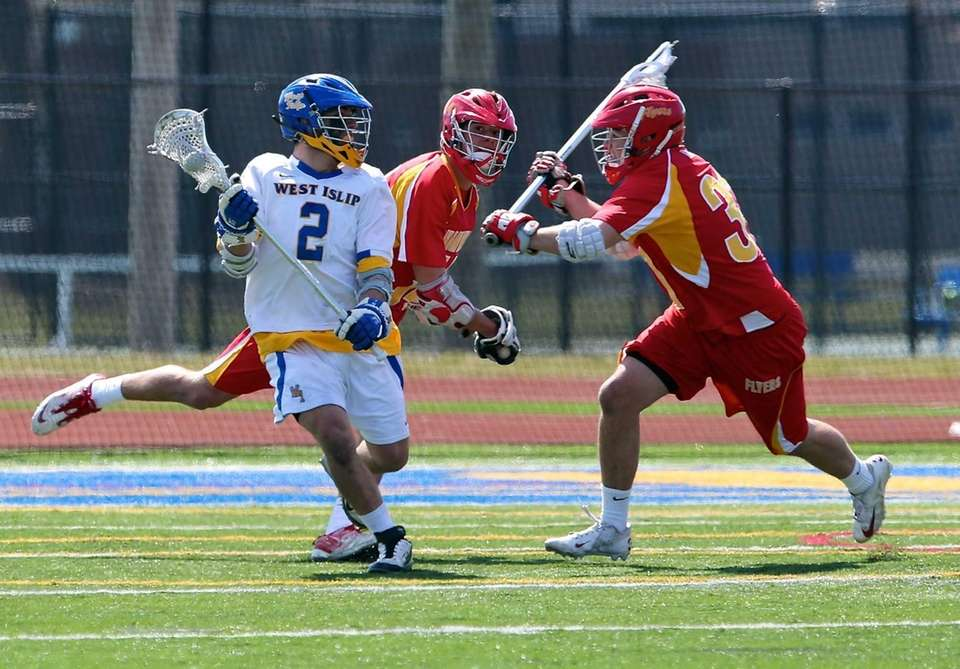 West Islip's Mike Moynihan looks to pass as