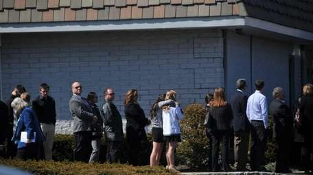 The long line of mourners waited to pay