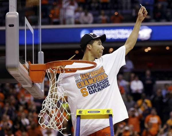 Syracuse guard Michael Carter-Williams celebrates after cutting down