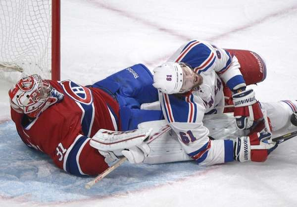 Rangers' Rick Nash, right, collides with Montreal Canadiens