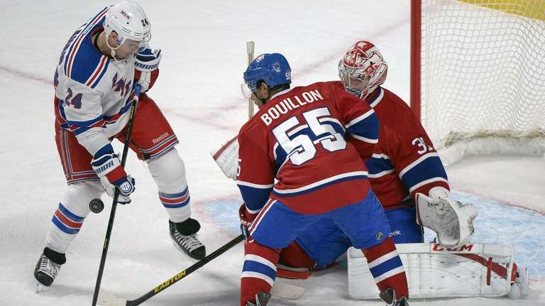 Montreal Canadiens goaltender Carey Price, right, makes a