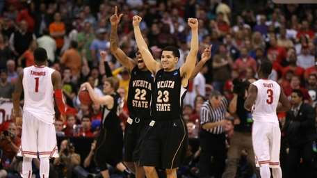 Fred Van Vleet and Carl Hall of the