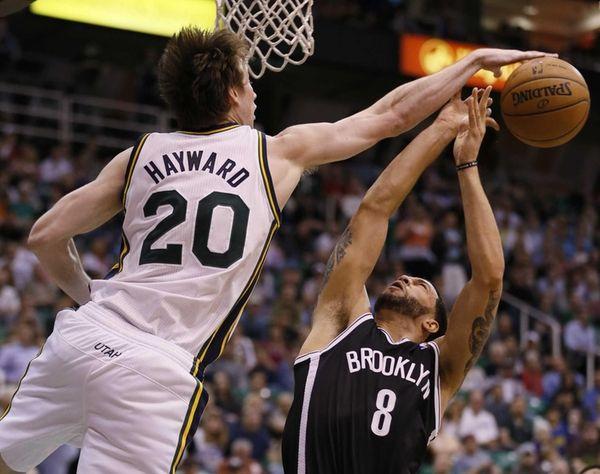 Nets' Deron Williams, right, has his shot blocked