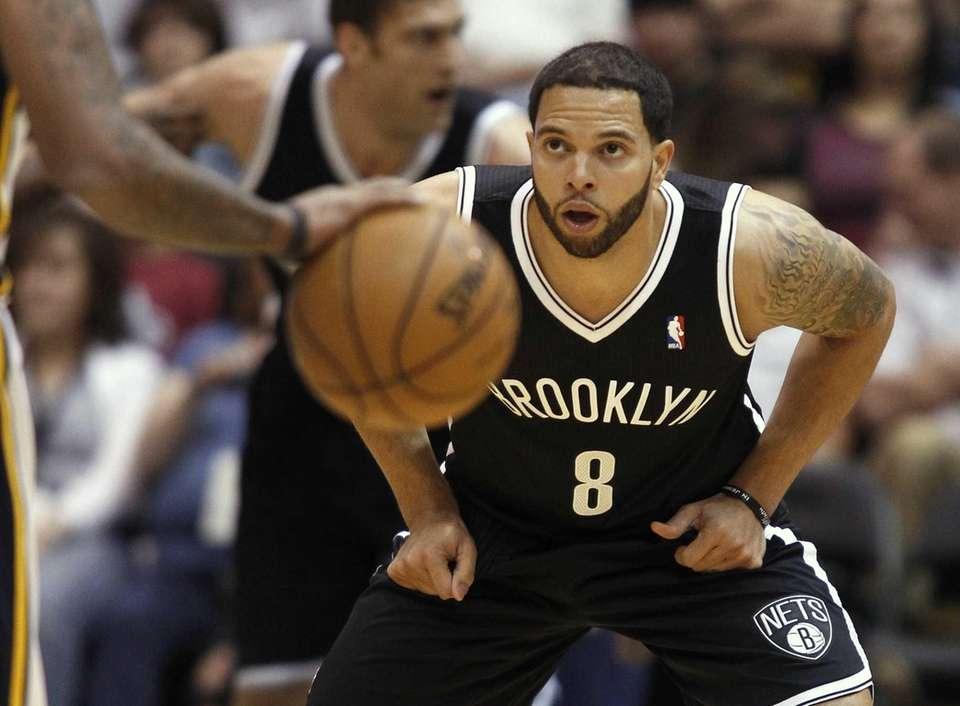 Nets' Deron Williams looks to defend against the
