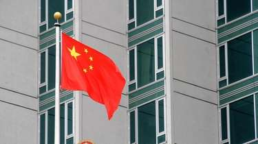 The Chinese flag flies outside its consulate in