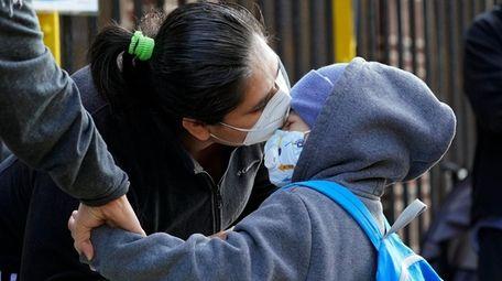 Maria Flores kisses her son, Pedro Garcia, 4,