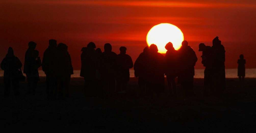People gather for an Easter sunrise service at