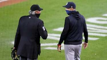 Umpire Paul Nauert #39 talks to manager Aaron