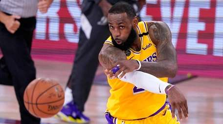 Lakers star LeBron James passes the ball in