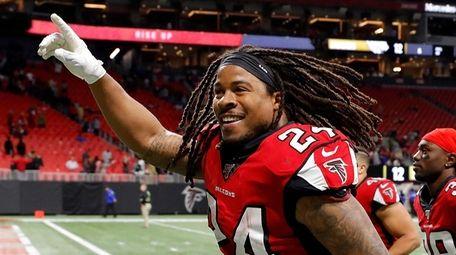 Devonta Freeman #24 of the Atlanta Falcons reacts