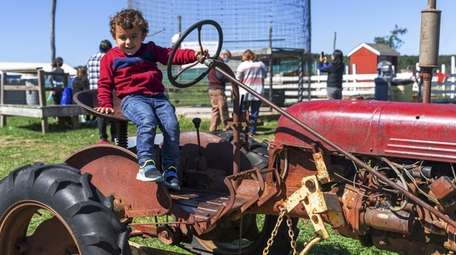 Jason Bourboulis, 3, from Laurel sits on the