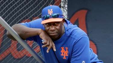 Mets hitting coach Chili Davis watches from the