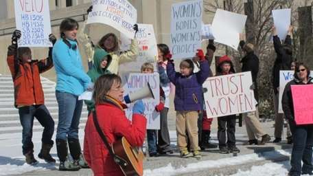 Kris Kitko leads chants of protest at an