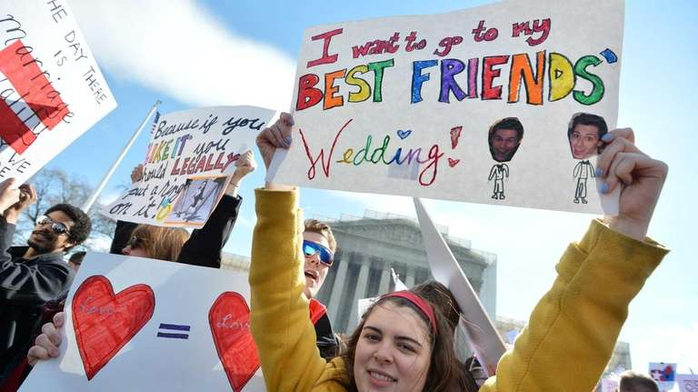 Same-sex marriage supporters demonstrate in front of the