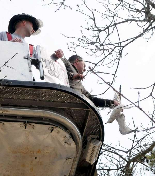 Center Moriches firefighter Greg Matonis (right) rescues a