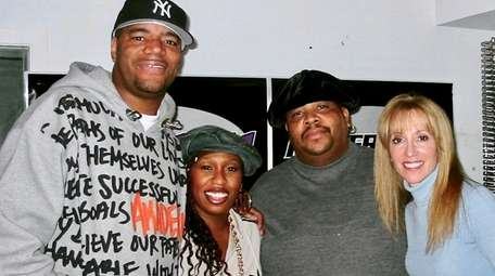 """Andre """"Doctor Dré"""" Brown (second from right) is"""