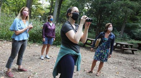 Jocelyn Anderson, of Manhattan, looks for birds at