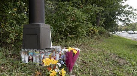 A makeshift memorial sits between exits 29 and