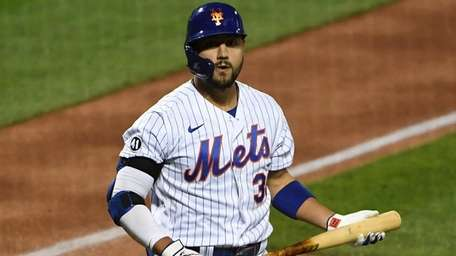 The Mets' Michael Conforto returns to the dugout