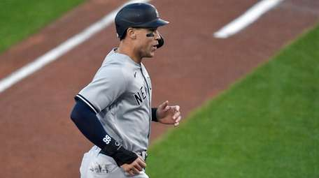 The Yankees' Aaron Judge reacts heads to the