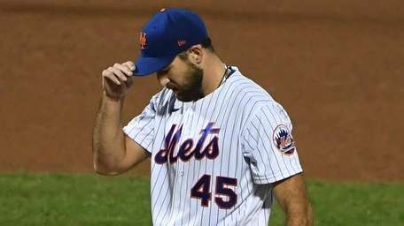 Mets starting pitcher Michael Wacha stands on the