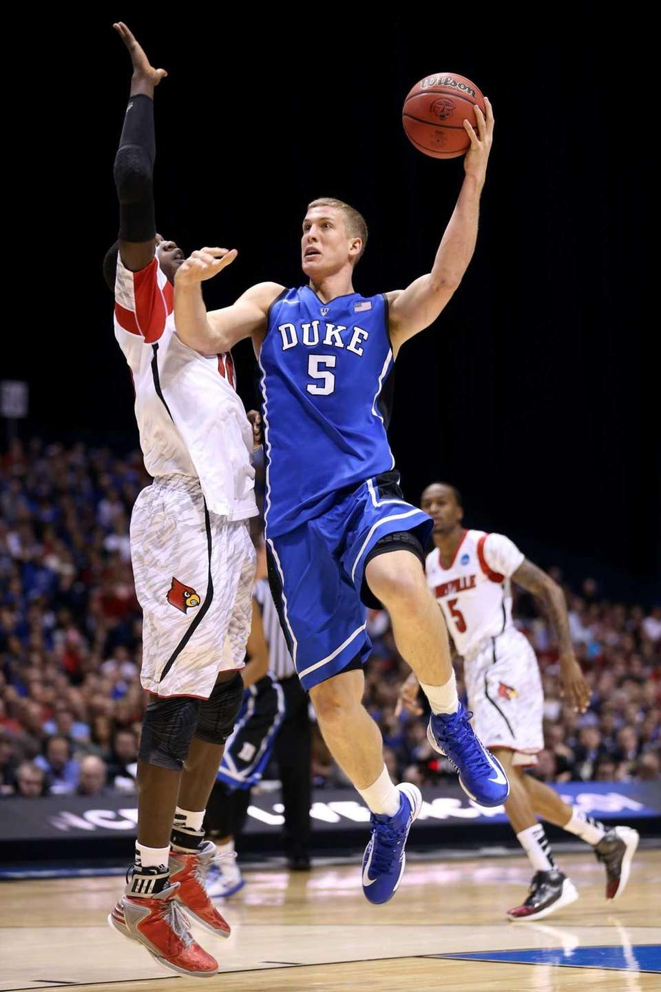 Mason Plumlee of the Duke Blue Devils attempts