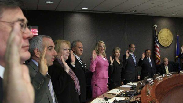 Lawmakers are sworn in to the Suffolk Legislature.