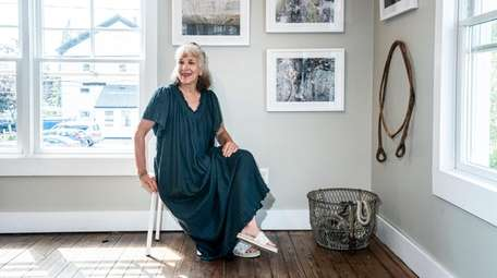 Longtime celebrity photographer Deborah Feingold poses after hanging
