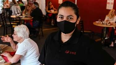 Nora Garcia, the owner of Cafe Red in