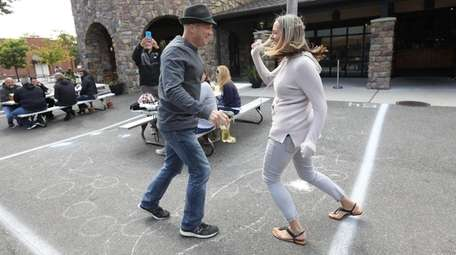 Suzanne and Jay Benjamin of Massapequa dance at