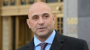 Craig Carton exits a Manhattan federal courthouse on