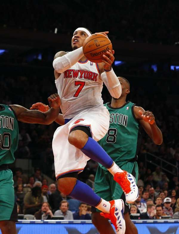 Carmelo Anthony of the Knicks goes to the