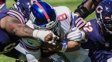 Giants quarterback Daniel Jones is tackled by Chicago