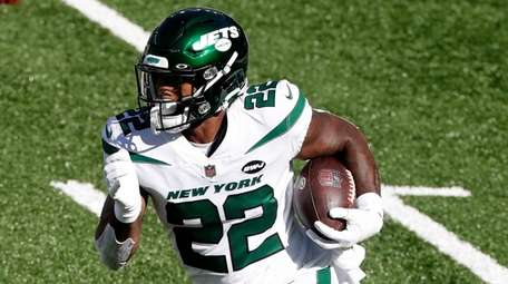 La'Mical Perine #22 of the Jets runs the