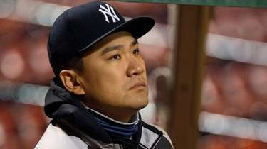 Yankees starting pitcher Masahiro Tanaka watches the game