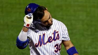 Mets' Michael Conforto reacts after striking out to