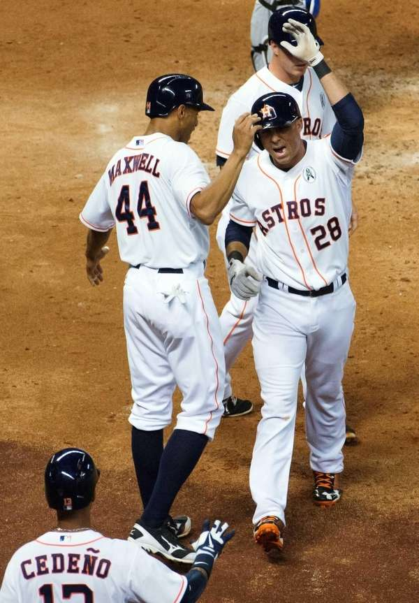 Houston Astros pinch hitter Rick Ankiel celebrates with