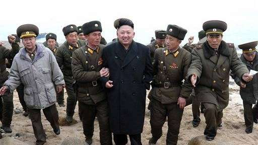 North Korean leader Kim Jong Un, center, walks