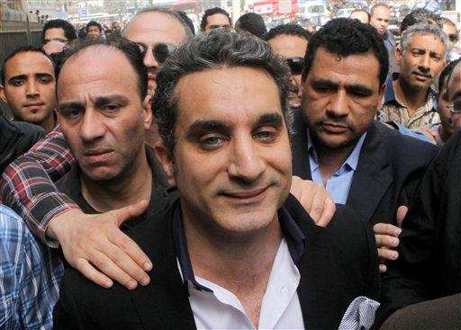 A bodyguard secures popular Egyptian television satirist Bassem