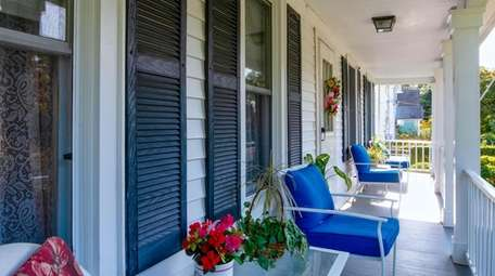 The charming front porch is covered, making it