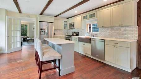 Granite counters gleam in the updated eat-in kitchen.